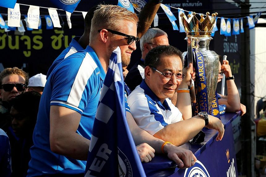 Leicester goalkeeper Kasper Schmeichel and owner Vichai Srivaddhanaprabha during the parade to celebrate the club's league title in Bangkok.
