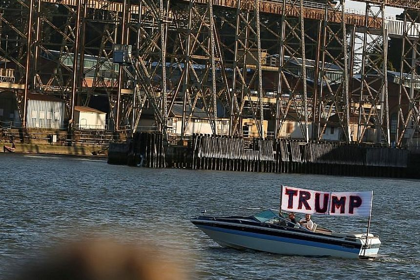 A boat with a sign showing support for presumptive Republican presidential nominee Donald Trump near Waterfront Park in Vallejo, California. The Federal Election Commission made public on Wednesday a 104-page financial disclosure form from Mr Trump.
