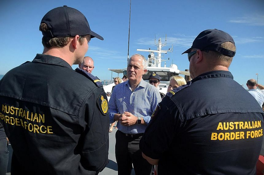 Mr Turnbull speaking to Border Force officers on Tuesday. The issue of Pacific detention camps for asylum-seekers has been a growing problem for the Prime Minister.