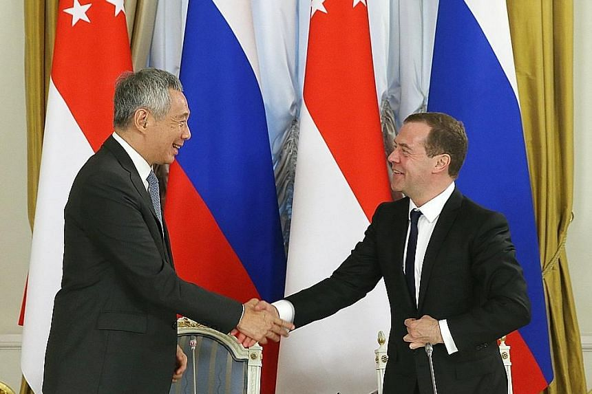 PM Lee and PM Medvedev at a media conference at the Government Reception House in Moscow yesterday. PM Lee will attend the Asean-Russia Commemorative Summit in Sochi today.