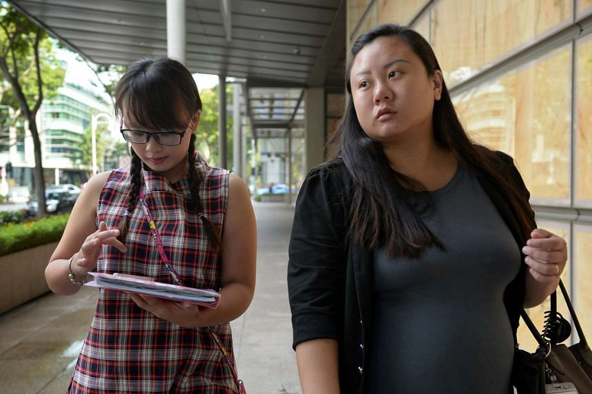 Sisters Isabella Ng (left), 25, and Michelle Ng, 26, exiting the High Court after a pre-trial conference on May 17, 2016.
