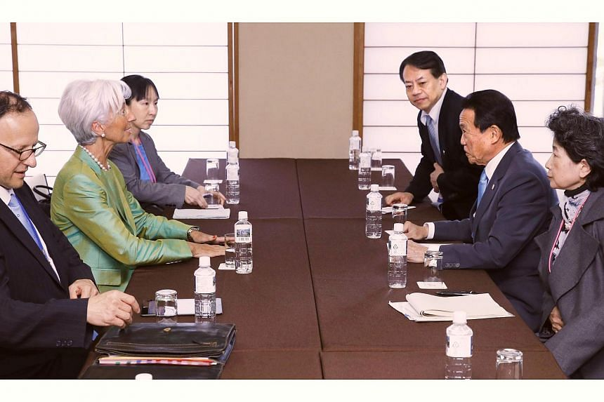IMF managing director Christine Lagarde (second from left) speaking with Japanese Finance Minister Taro Aso (second from right) on the sidelines of the G7 meeting in Sendai, Japan, on May 20.