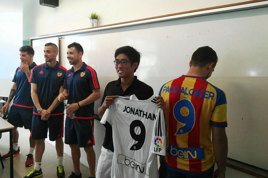 Valencia players Santi Mina, Jaume Domenech, Javi Fuego and Paco Alcacer surprised RI footballer Jonathan Chua (second from right) in class and presented him with an autographed jersey. Club legends Gaizka Mendieta and David Albelda were also present