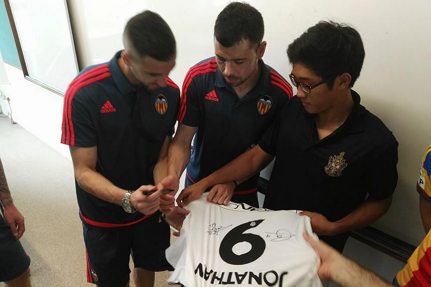 Valencia players Santi Mina, Jaume Domenech, Javi Fuego and Paco Alcacer surprised RI footballer Jonathan Chua (right) in class and presented him with an autographed jersey. Club legends Gaizka Mendieta and David Albelda were also present.