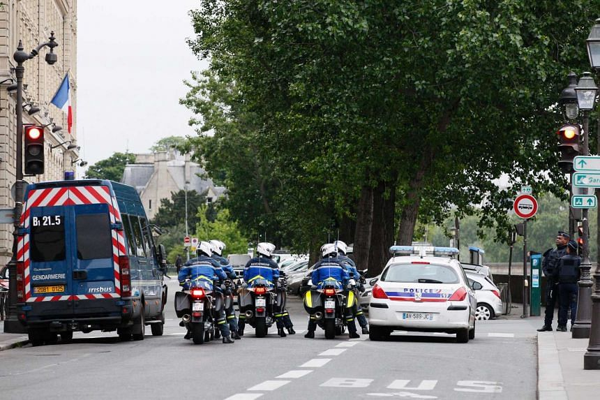 French police and Gendarmerie block a street as a convoy transports Salah Abdeslam to the Paris courthouse for his first questioning by anti-terror judges, on May 20, 2016.