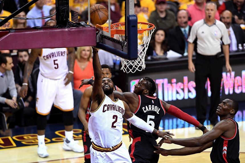 Kyrie Irving #2 of the Cleveland Cavaliers driving to the basket in the first quarter against DeMarre Carroll #5 of the Toronto Raptors during the 2016 NBA Playoffs at Quicken Loans Arena on May 17, 2016.