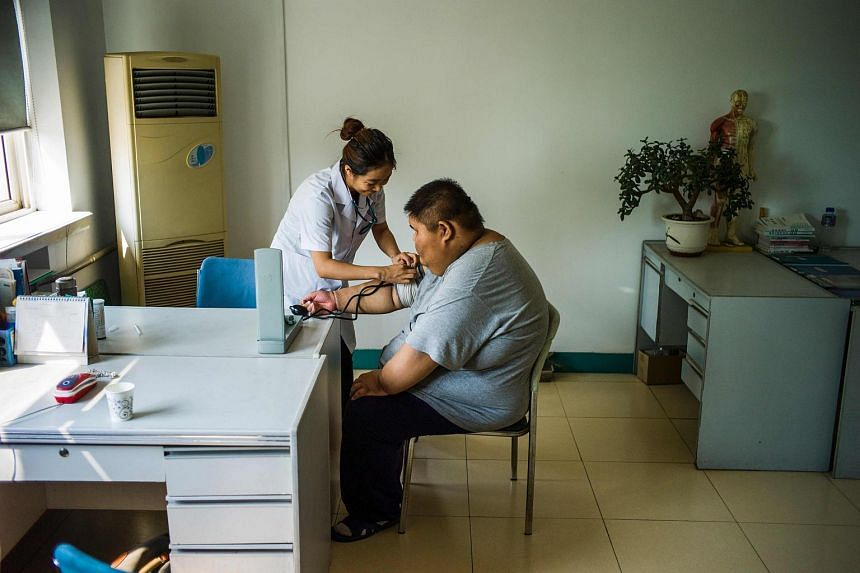A nurse attending to a patient at a hospital in Tianjin.