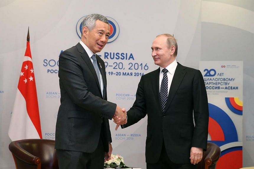 PM Lee Hsien Loong (left) shaking hands with Russian President Vladimir Putin during a meeting on the sidelines of the Asean-Russia Commemorative Summit in Sochi on May 19.