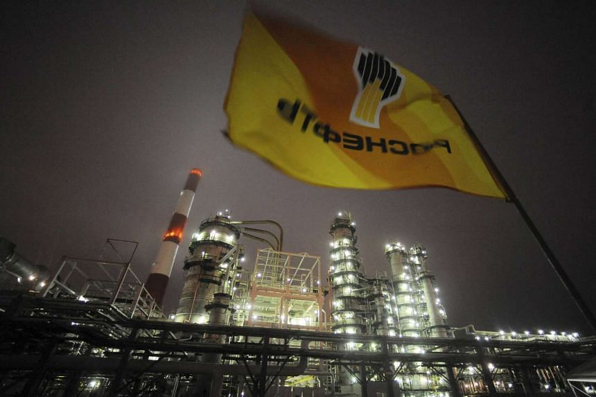 A flag with the logo of Russian oil firm Rosneft is seen over the Novokuibyshevsk refinery near Samara, Russia.