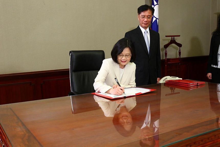 Taiwan's President Tsai Ing-wen signing after swearing in at the Presidential Office in Taipei, Taiwan, on May 20, 2016.
