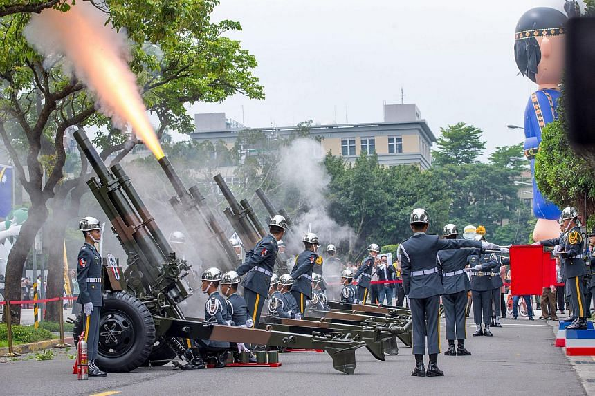 Soldiers firing cannons during a rehearsal for president-elect Tsai Ing-wen's inauguration in Taipei on May 18.