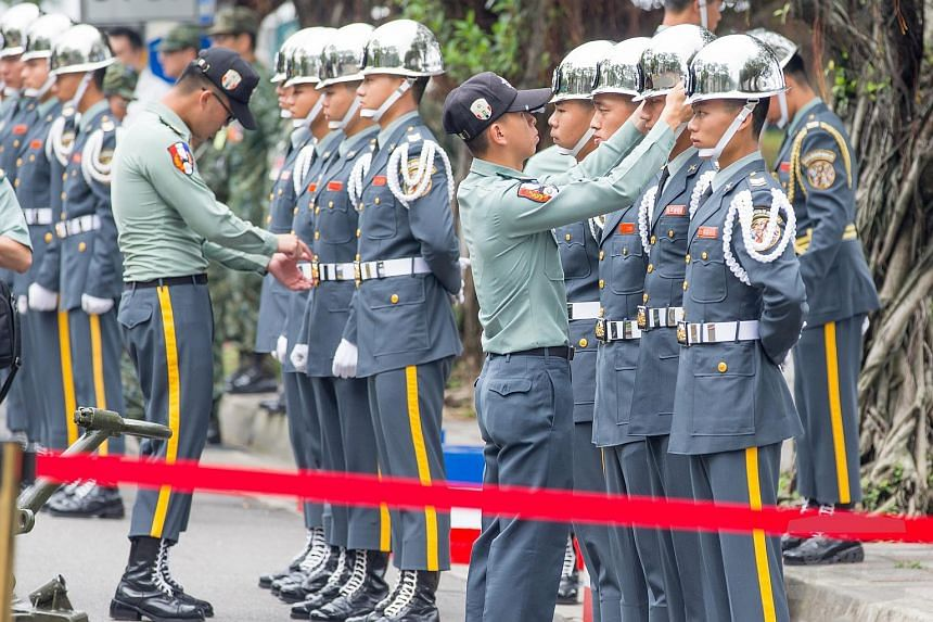 Military officers checking the uniforms of soldiers during a rehearsal for president-elect Tsai Ing-wen's inauguration in Taipei on May 18.