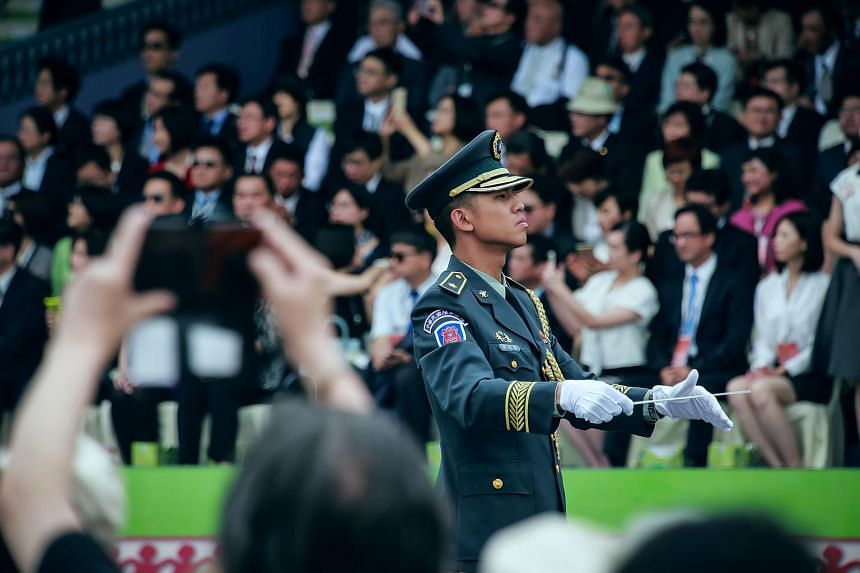 A military band conductor performing during the inauguration ceremony for Taiwan's incoming president Tsai Ing-wen, at the Presidential Palace in Taipei, Taiwan, on Friday, on May 20, 2016.