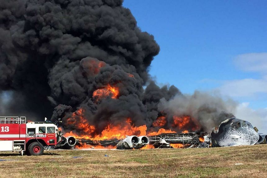 The B-52 bomber is seen just after it crashed at Andersen Air Force Base on the Pacific island of Guam.