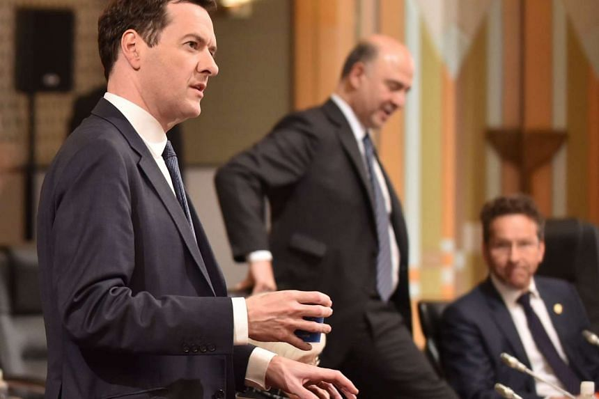 Britain's Chancellor of the Exchequer George Osborne (left) attends the first session of the G7 Finance Ministers and Central Bank Governors' Meeting in Sendai, northern Japan, on May 20, 2016.