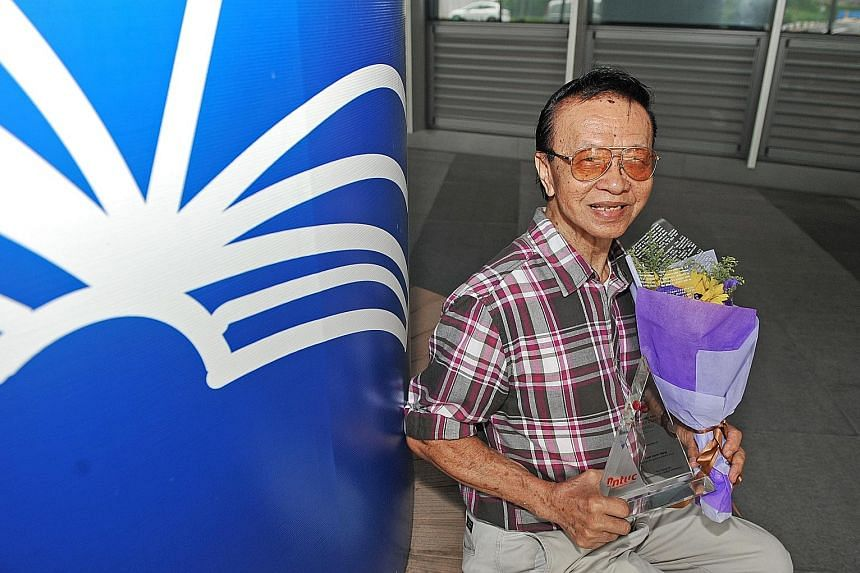 Mr Goh, who has not taken sick leave for the past 15 years, shows off his May Day Partnership Award. The 85-year-old was one of 63 individuals and firms honoured yesterday by the labour movement.