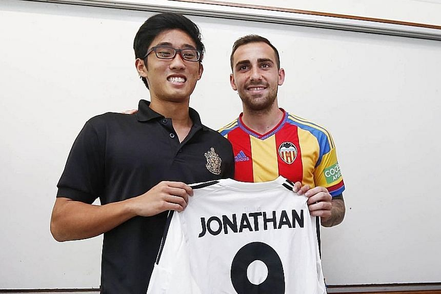 """Paco Alcacer presenting RI striker Jonathan Chua with a personalised jersey. The Valencia captain and five other former and current players paid him an unannounced class visit. Alcacer stressed that in football """"you have to try and do the right thing"""