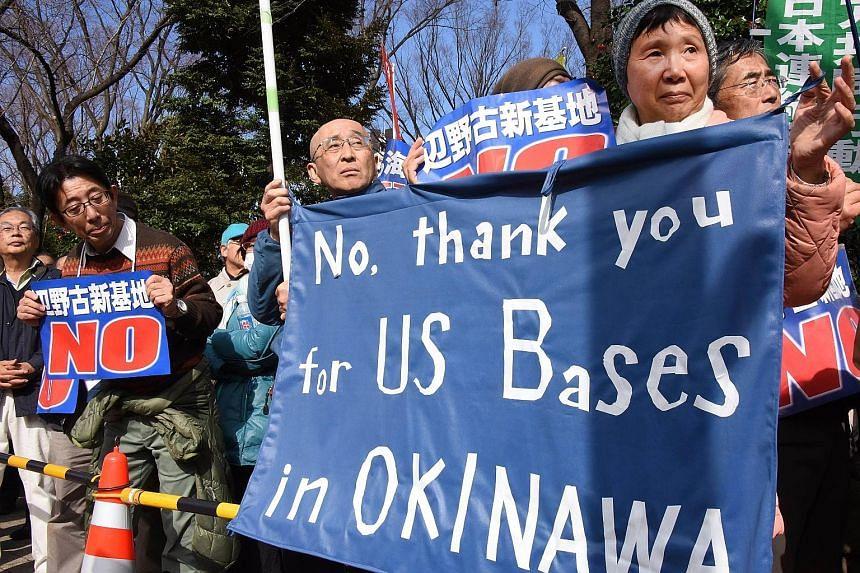 Protesters at a rally in front of the National Diet in Tokyo in February this year to raise objections to plans for a new US military base on Okinawa. Crimes by American personnel are a potent rallying point for Okinawans and others in Japan who oppo