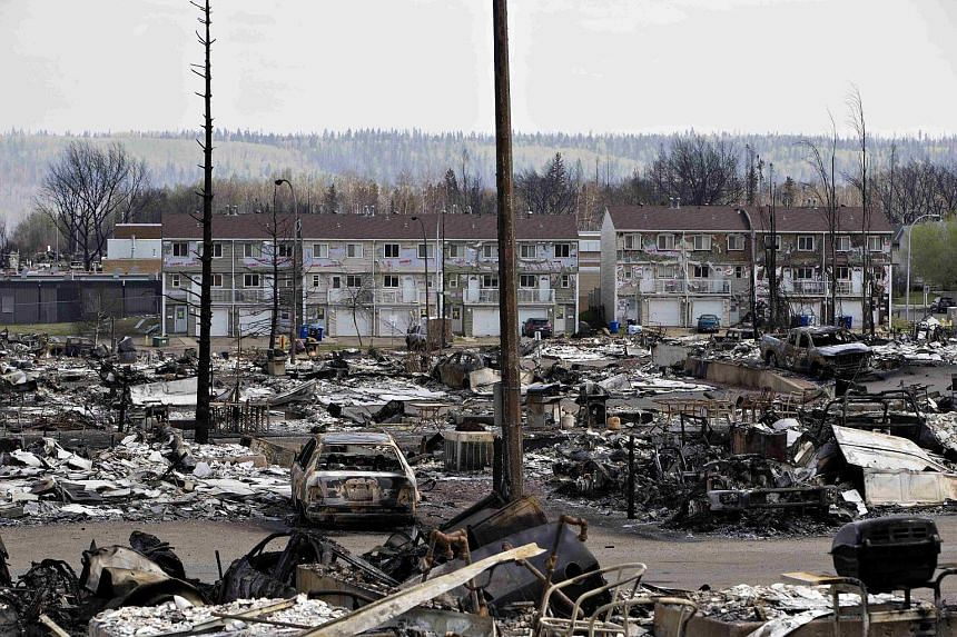 The devastated neighbourhood of Abasand is shown after being ravaged by a wildfire in Fort McMurray, Alberta, Canada, on May 13, 2016.