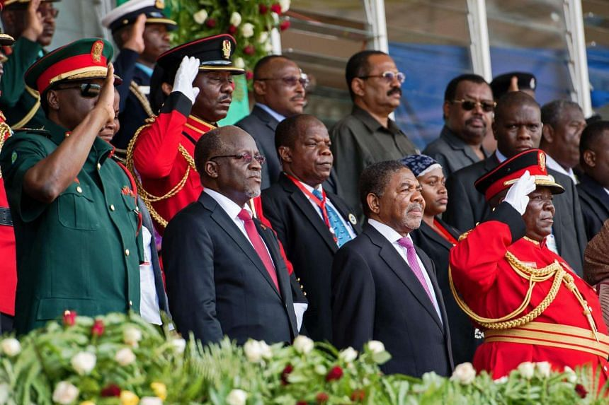 Tanzanian president John Magufuli (second from left) in Stone Town, Zanzibar, on March 24, 2016.