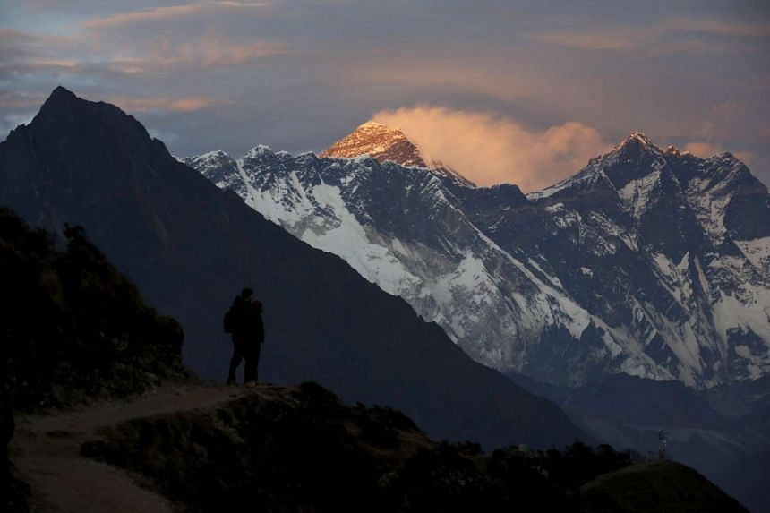 Light illuminates Mount Everest during sunset in Solukhumbu district, also known as the Everest region, on Nov 30, 2015.