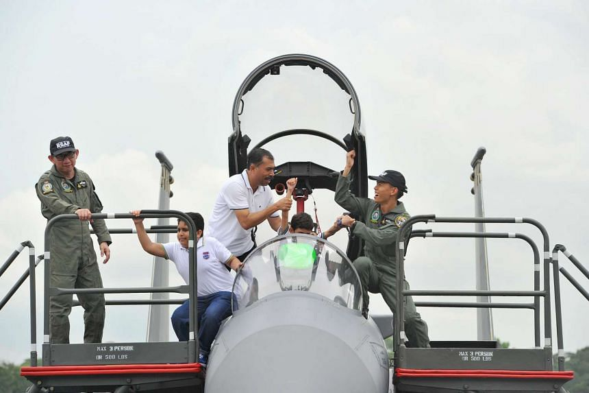 Members of the public taking a look at the cockpit of the F-15SG at the RSAF Open House at Paya Lebar Air Base, on May 21, 2016.