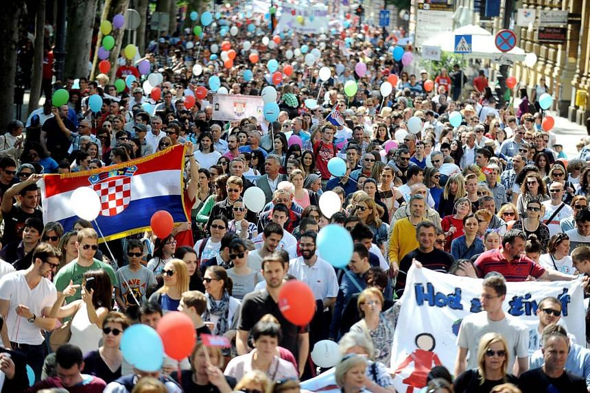 People take part in a pro-life march in Zagreb on May 21, 2016, raising rights groups concerns over a possible abortion ban by the conservative rulers.