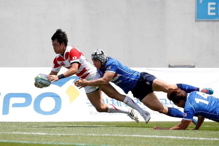 Japan's Takuhei Yasuda scores a try against South Korea at the Asian Rugby Championship, on May 21, 2016.