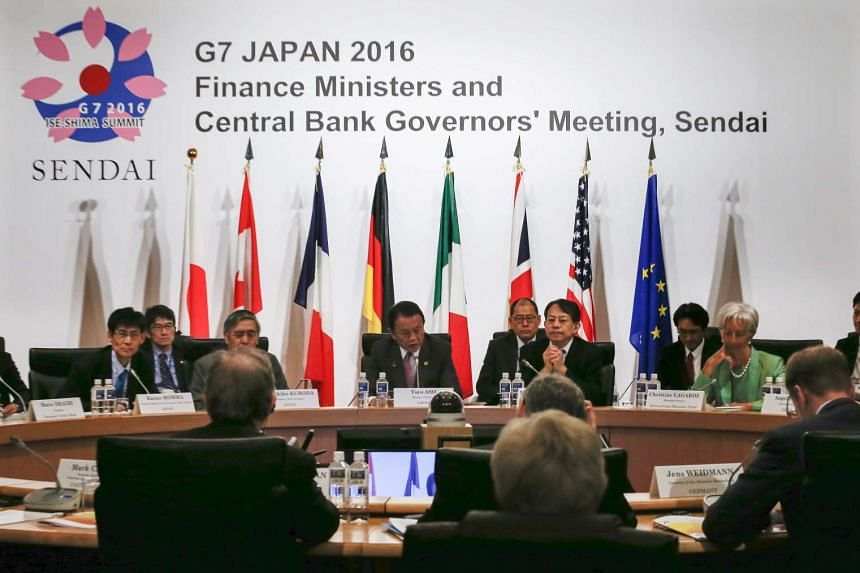 Japanese Finance Minister Taro Aso (centre) chairing the G7 Finance Ministers and Central Bank Governors meeting at Akiu in Sendai, Miyai Prefecture, northern Japan, on May 20, 2016.