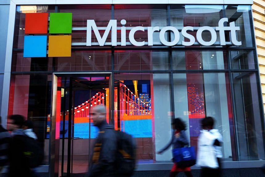 People walking past a Microsoft office in New York.