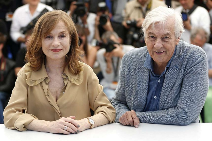 Dutch director Paul Verhoeven (right) and French actress Isabelle Huppert (left) pose during the photocall for Elle.