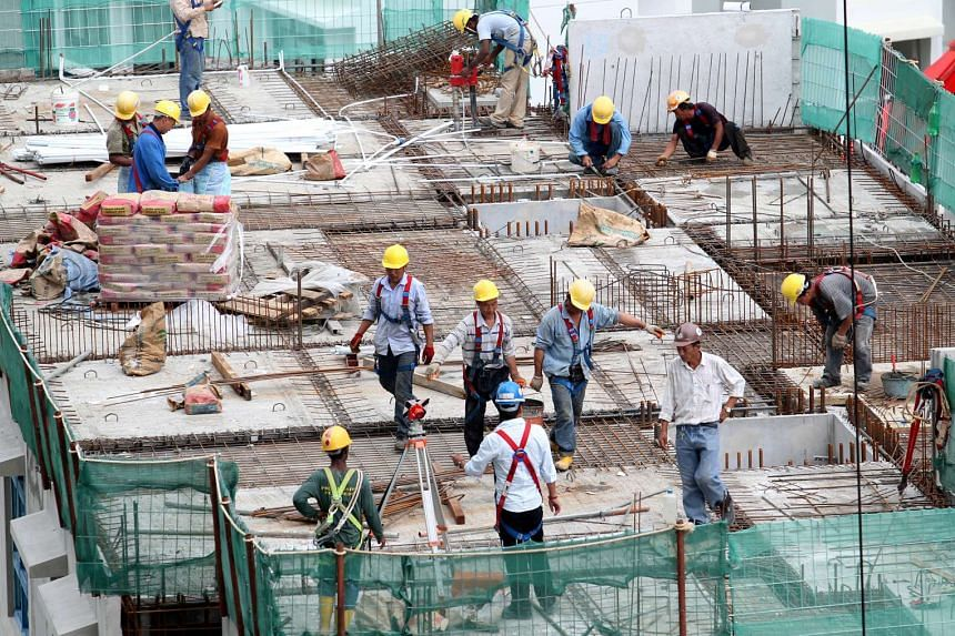 Construction workers at a HDB construction site in Sengkang West Ave on Aug 20, 2012.