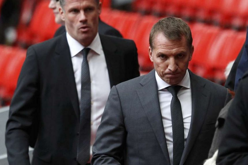 Rodgers (above right) spent three years at Liverpool before being sacked in October.