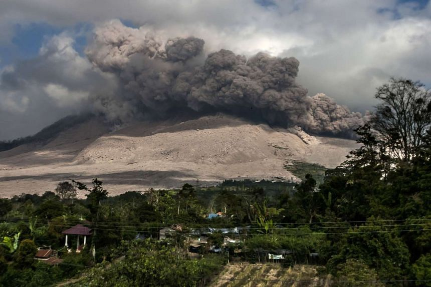 Mount Sinabung spews volcanic ash on Feb 26, 2016.