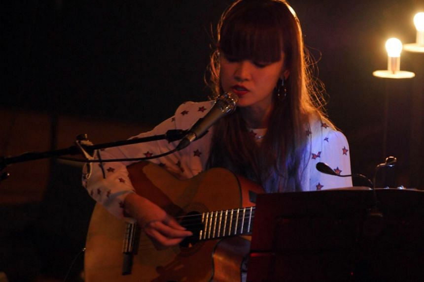 The sultry, soaring voice of Aspidistrafly's April Lee (above) was filled with melancholic introspection.
