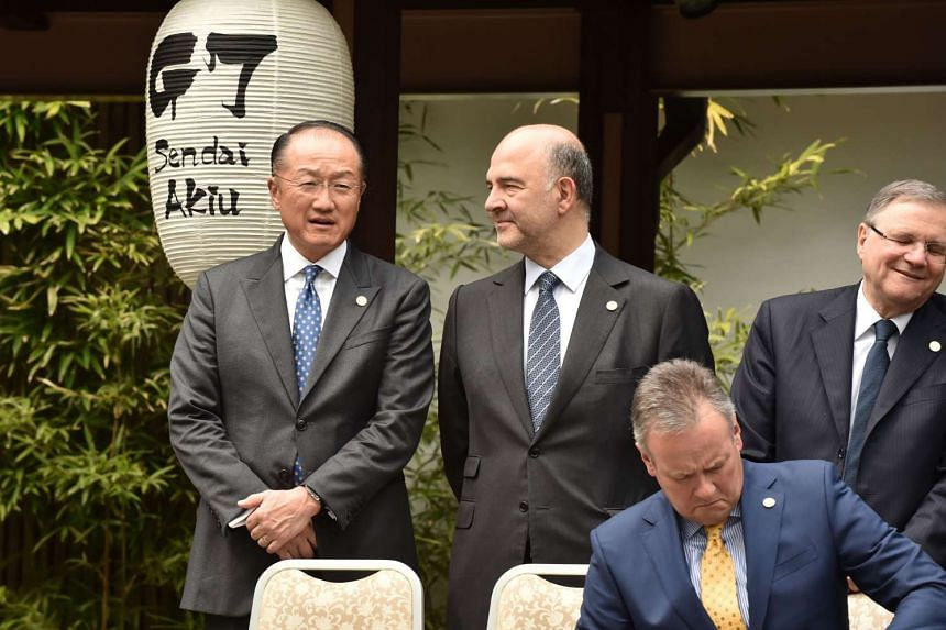 President of the World Bank Group Jim Yong Kim (left) talking with European Commission Commissioner Pierre Moscovici (second from left) at the G7 Finance Ministers and Central Bank Governors' Meeting in Sendai on May 20, 2016.