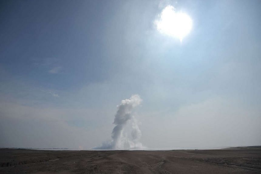 White smoke spewing from the centre of a mud volcano area in Sidoarjo, East Java on March 28, 2016.