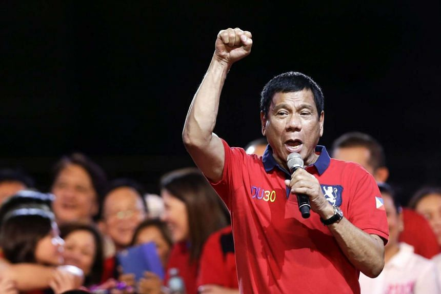 Philippines' president-elect Rodrigo Duterte speaks to supporters during the 'miting de avance' in Manila, Philippines, on May 7, 2016.