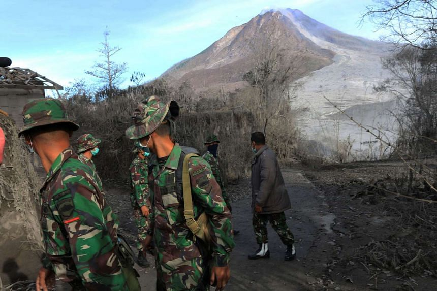 Indonesian soldiers search an area following a deadly eruption of Mount Sinabung volcano in Gamber Village, North Sumatra, Indonesia on May 22, 2016.