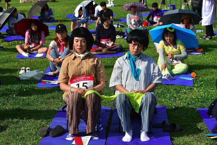 """Contestants taking part in Seoul's """"space-out"""" competition on May 22, 2016."""