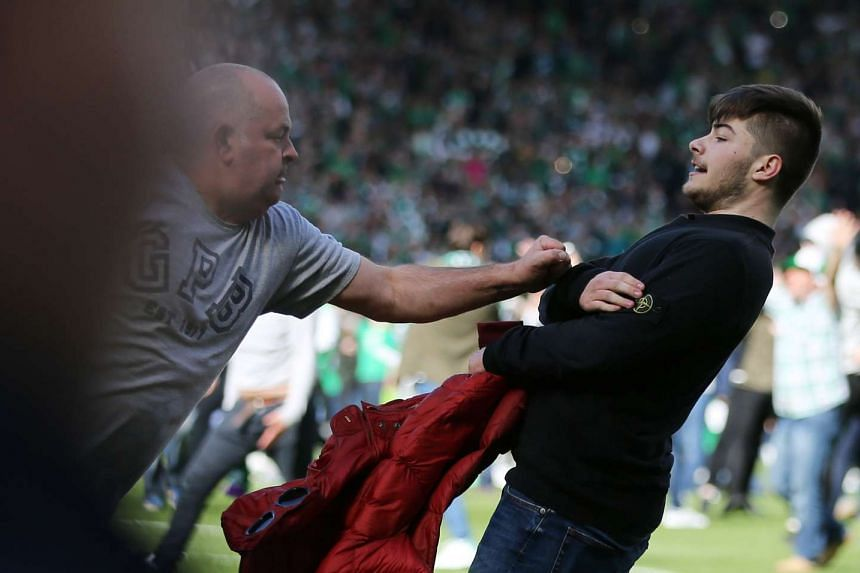 Fans clashing on the pitch after Hibernian defeated Rangers in the Scottish Cup Final in Glasgow on May 21, 2016.