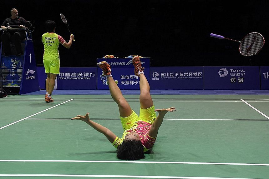 Chen Qingchen (right) and Tang Yuanting are ecstatic after sealing the winning point against Chang Ye Na and Lee So Hee for China's 14th Uber Cup title.