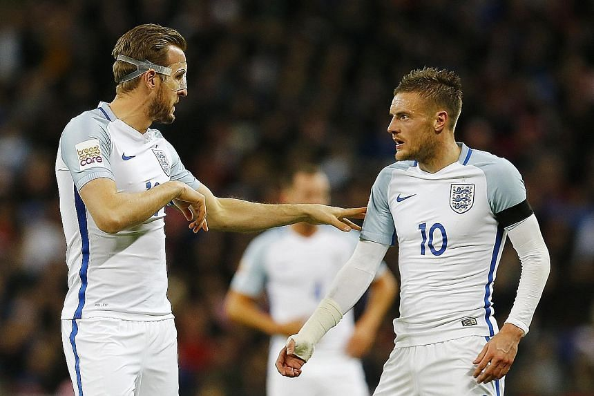 Harry Kane (far left) passing on instructions to Jamie Vardy after coming on as a substitute for England against the Netherlands at Wembley in March. Vardy scored in the 1-2 loss and both will fancy their starting chances at Euro 2016 next month if m