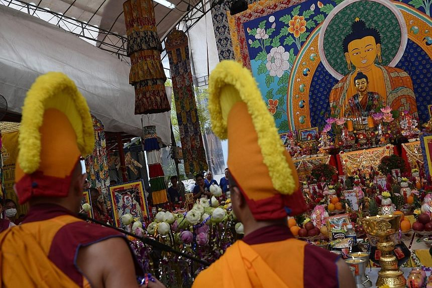 An image of Buddha in silk, that is four storeys high, was the centrepiece of celebrations at the Thekchen Choling temple in Jalan Besar.