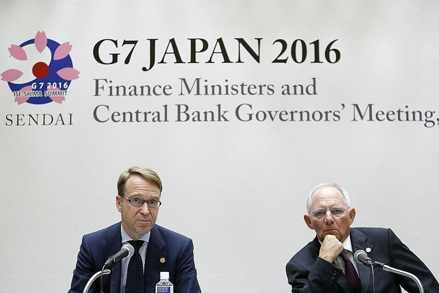 Bundesbank's Mr Weidmann (left) and German Finance Minister Wolfgang Schauble at yesterday's news conference. The G-7 finance chiefs reaffirmed a pledge not to deliberately weaken their currencies.