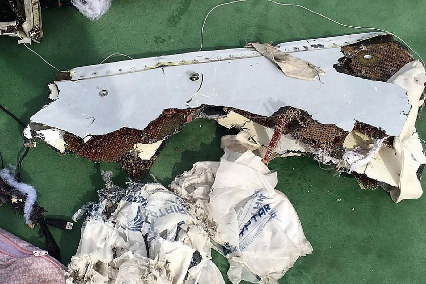 An Egyptian army spokesman published pictures of some of the wreckage recovered so far, including a safety vest and what appears to be the shredded remains of a seat, on its official Facebook page. Analysis of the debris is likely to be key to determ