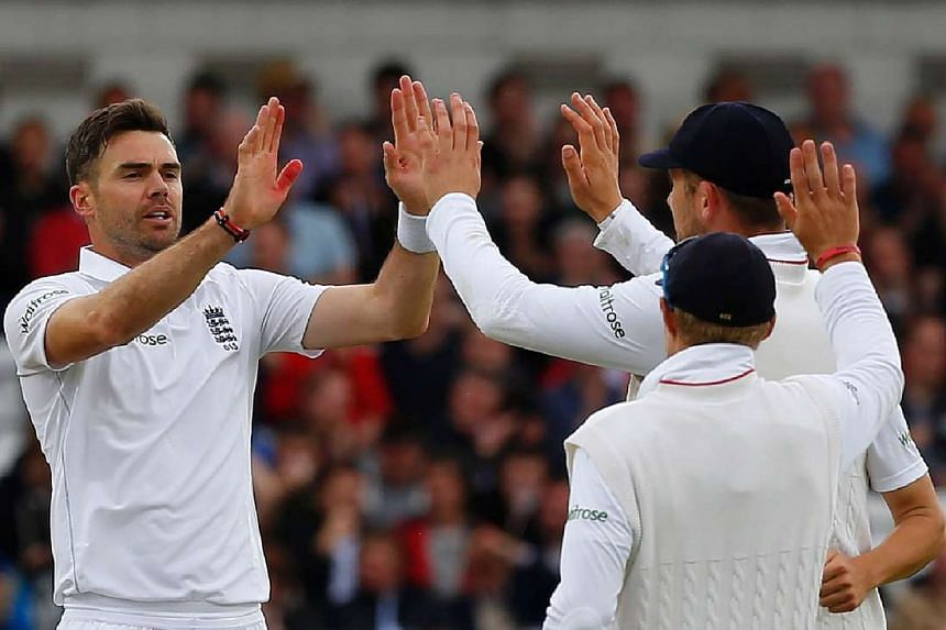 England's James Anderson (left) celebrates after taking the wicket of Dasun Shanaka (not pictured) for four runs on the third day of the first Test.