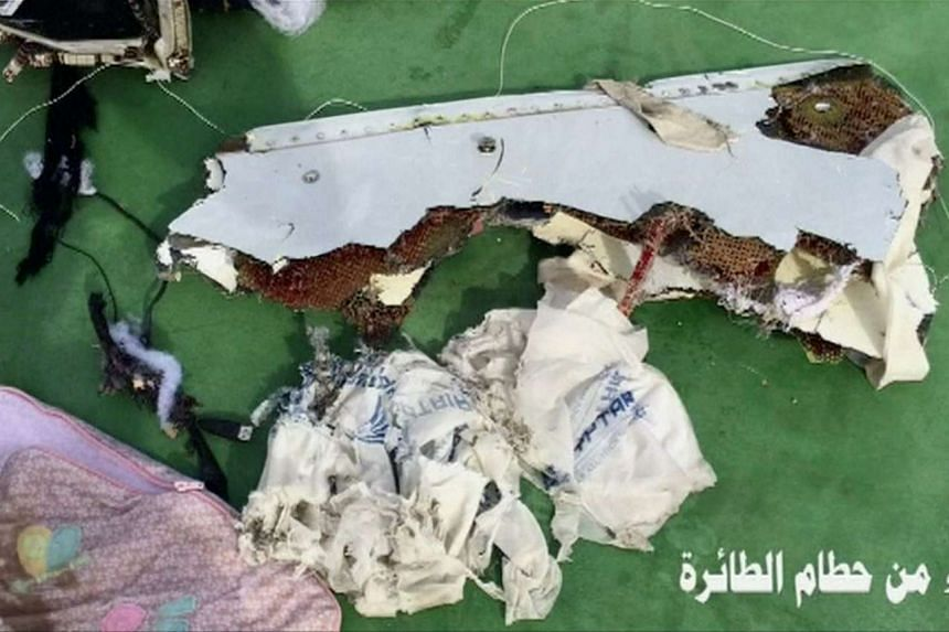 """Recovered debris of the EgyptAir jet that crashed in the Mediterranean Sea is seen with the Arabic caption """"part of plane wreckage""""."""