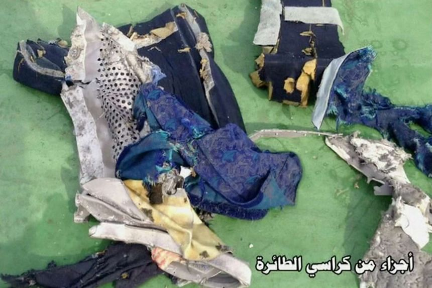 """Recovered debris of the EgyptAir jet that crashed in the Mediterranean Sea is seen with the Arabic caption """"part of plane chair""""."""