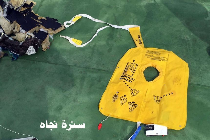 """Recovered debris of the EgyptAir jet that crashed in the Mediterranean Sea is seen with the Arabic caption """"life jacket""""."""